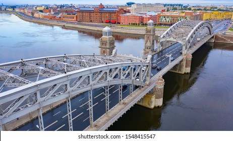 Saint Petersburg. Russia. Top view of Bolsheokhtinsky bridge. Peter the Great bridge on a cloudy day. Rivers Of Petersburg. Bridges Of St. Petersburg. Travel to the Russian Federation.