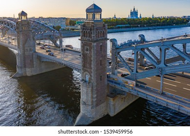 Saint Petersburg. Russia. Towers of Peter the Great Bridge. Bolsheokhtinsky bridge on a summer day. Canals of St. Petersburg. Peter the Great Bridge aerial view. Traveling by car in Russia.