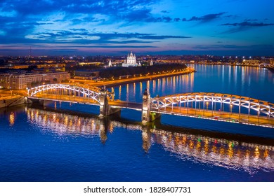 Saint Petersburg. Russia. White nights in St. Petersburg. Bridges Of St. Petersburg. View from the height of the Peter the Great bridge and the evening city. Bolsheokhtinsky bridge across the Neva.