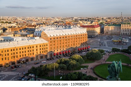 Saint Petersburge, Russia - September 17, 2017: Aerial view St. Isaac's Cathedral over old buildings and roads around St. Isaac's square before sunset.