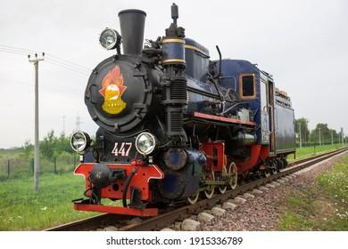 Saint Petersburg-Russia-25.09.2020: Railway transport. Vintage retro steam locomotive. Translation: Leningrad young railwayman