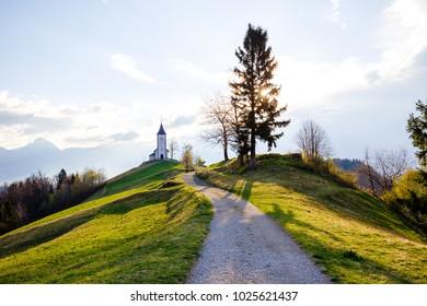 Saint Primoz church on a hillside in the spring, Jamnik, Slovenia