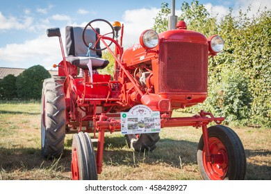 Saint Reverend, France - July 24, 2016 : old tractor mc cormick for vintage car show during the city's party