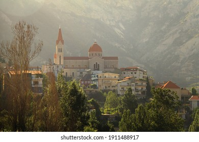 Saint Saba church in the Lebanese town of Bcharre surrounded with trees. - Shutterstock ID 1911488917