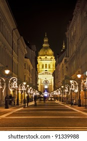 Saint Stephens Basilika at the end of a street at night in Budapest Hungary