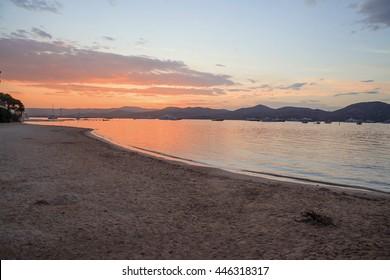 Saint Tropez beach at sunset french riviera, mediterranean sea