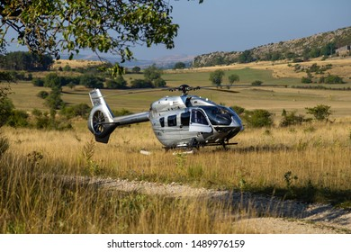 saint tropez, cannes/france - 08 25 2019: privet zilver airbus helicopter landed in random field