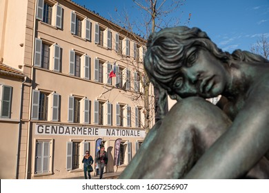 SAINT TROPEZ, FRANCE - DECEMBER 31, 2019: The shooting place of the french comedy of Gendarmes de Saint Tropez with the actor Luis de Funes. In the foreground blurred statue of actress Brigitte Bardot