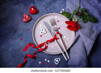 Saint Valentine Dinner concept with rose and heart love symbols, romantic dinner invitation