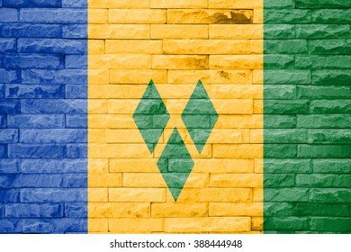 saint vincent and the grenadines flag a brick wall background