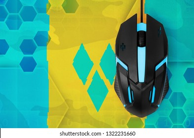Saint Vincent and the Grenadines flag  and computer mouse. Concept of country representing e-sports team