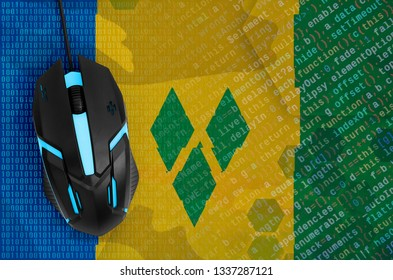 Saint Vincent and the Grenadines flag  and computer mouse. Digital threat, illegal actions on the Internet