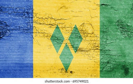Saint Vincent and the Grenadines flag with grunge texture background.