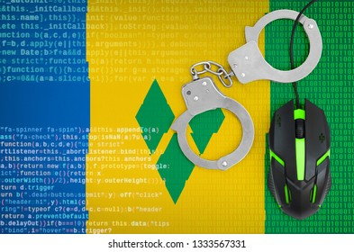 Saint Vincent and the Grenadines flag  and handcuffed computer mouse. Combating computer crime, hackers and piracy