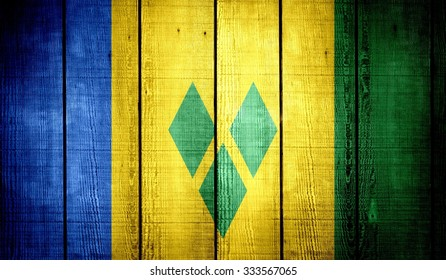 Saint Vincent and the Grenadines Flag on old wood texture background
