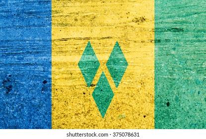 Saint Vincent and the Grenadines flag on Vintage background