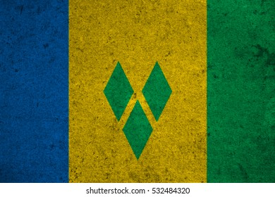 Saint Vincent and the Grenadines flag on an old grunge background