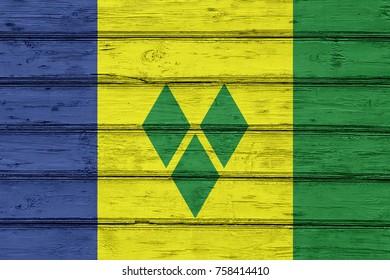 Saint Vincent Grenadines flag on wood texture background