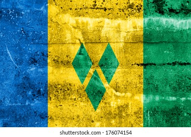 Saint Vincent and The Grenadines Flag painted on grunge wall
