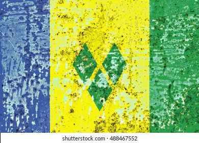The Saint Vincent Grenadines flag painted on grunge metal