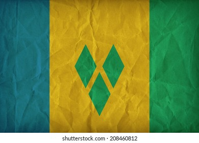 Saint Vincent and The Grenadines flag pattern on the paper texture ,retro vintage style