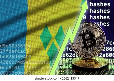 Saint Vincent and the Grenadines flag and rising green arrow on bitcoin mining screen and two physical golden bitcoins
