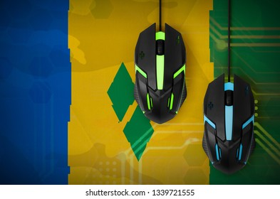 Saint Vincent and the Grenadines flag  and two mice with backlight. Online cooperative games. Cyber sport team
