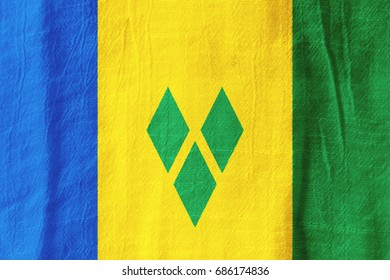 Saint Vincent and the Grenadines national flag from fabric for graphic design.