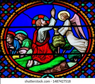 Saint-Adresse, France - August 15, 2019: Stained Glass in the Chapel of Notre-Dame-des-flots (1857) in Sainte Adresse, Le Havre, France, depicting Jesus Praying in the Garden of Gethsemane