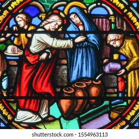 Saint-Adresse, France - August 15, 2019: Stained Glass in Notre-Dame-des-flots (1857) in Sainte Adresse, Le Havre, France, depicting Jesus transforming water into wine at the Marriage at Cana