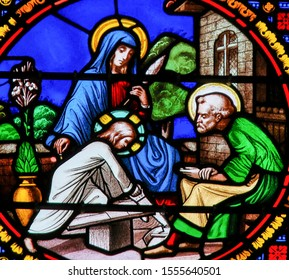 Saint-Adresse, France - August 15, 2019: Stained Glass in the Chapel of Notre-Dame-des-flots (1857) in Sainte Adresse, depicting the Holy Family with Jesus, Mary and Joseph - Ora et Labore