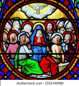 Saint-Adresse, France - August 15, 2019: Stained Glass in the Chapel of Notre-Dame-des-flots (1857) in Sainte Adresse, Le Havre, France, depicting Pentecost