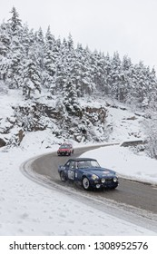 SAINT-AGREVE, FRANCE, February 3, 2019 : Competitors facing the snow on Ardeche roads. . Rallye Historique is reserved to those cars which have participated in the Rallye Monte-Carlo before 1980.