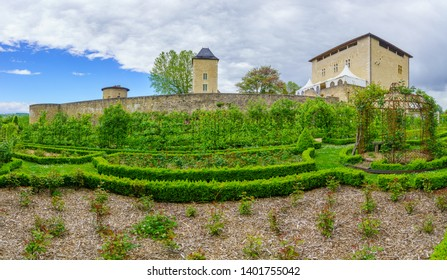 Saint-Bernard, France - May 04, 2019: View of the chateau (castle) and its gardens in Saint-Bernard, Ain department, France