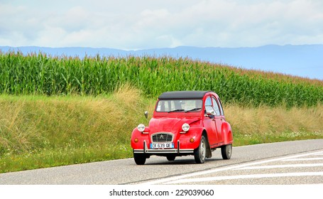 SAINT-BLAISE, FRANCE - AUGUST 7, 2014: Retro car Citroen 2CV at the interurban road.