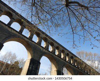 Saint-Clement Aqueduct (known as Arceaux aqueduct) on a sunny summer day in Montpellier, France