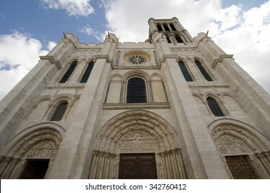 SAINT-DENIS, FRANCE - SEPTEMBER 14, 2015: The Basilica of Saint Denis, completed in 1144, is the first major structure built in the Gothic style.  The Abbey is the burial site of the kings of France.