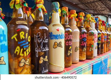 Sainte Anne, Guadeloupe, 11th may 2015: Traditional flavored rum bottles on the desk of a market stall in Sainte Anne, Guadeloupe.