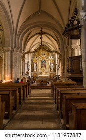 SAINTE MERE EGLISE, FRANCE - June 12, 2018: Interior of Sancte Marie Ecclesia translated as Church of St. Mary in Sainte Mere Eglise, Normandy, France.