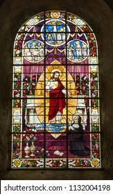 SAINTE MERE EGLISE, FRANCE - June 12, 2018: Interior stained glass window of Sancte Marie Ecclesia translated as Church of St. Mary in Sainte Mere Eglise, Normandy, France.