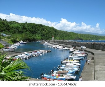 Sainte Rose / La Reunion - December 2009: Small fishing and leisure boats in the idyllic port of Sainte-Rose