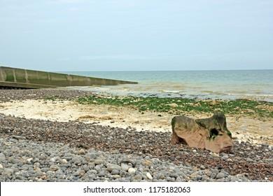 Sainte-Marguerite-sur-mer. Pebbles, sand and ocean. (Somme Bay - France).