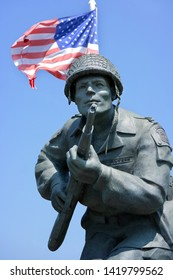 "SAINTE-MARIE-DU-MONT, NORMANDY, FRANCE - JULY 24, 2014 Statue of Richard Davis ""Dick"" Winters best known for commanding Easy Company, part of the 101st Airborne Division, during World War II."