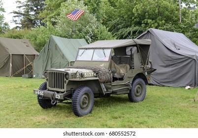 SAINTE-MERE-EGLISE, FRANCE - CIRCA JUNE 2017. Historical World War II reenactment military camp commemorating  the June 6, 1944 invasion (DDay) of Europe. circa 2017