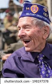 SAINTE-MERE-EGLISE, FRANCE - JUNE 6, 2014: An american veteran in the parade during the commemoration of the 70th anniversary of D-Day.