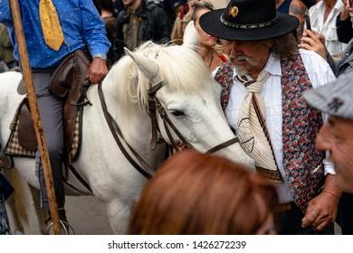 Saintes Marie de la mer, France - May 24, 2019: A gardian and a Camargue horse around the people in Saintes Marie de la mer