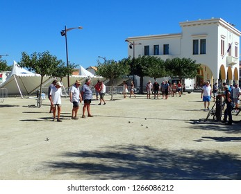 Saintes-Maries-de-la-Mer/France - August 12 2016: Pétanque match in Saintes-Maries-de-la-Mer. Pétanque is a form of boules specific to Southern France.