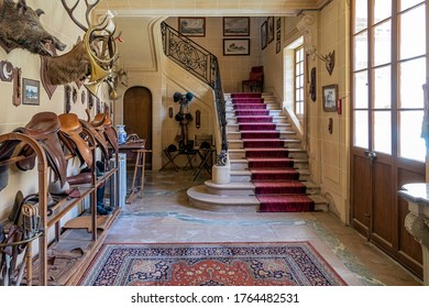 SAINT-FARGEAU YONNE, FRANCE - JUNE 24, 2020. Entrance hall of Château St Fargeau. Exhibition of a collection of equestrian accessories and hunting trophies.
