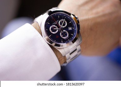Saint-Imier, Switzerland 31.03.2020 - Closeup fashion image of Longines watch on wrist of man Longines man watch stainless steel case black clock face dial stainless steel bracelet swiss quartz watch