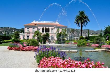 Saint-Jean-Cap-Ferrat / France — August 6, 2010: the building of Villa Ephrussi de Rothschild, a beautiful villa on the Cote d'Azur (French Riviera). The villa park consists of nine gardens